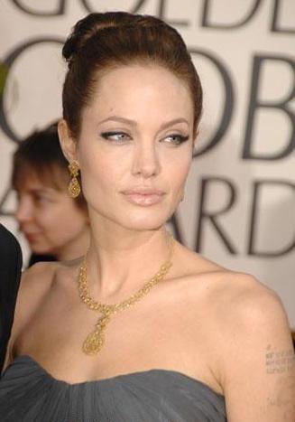 Jolie-Beckham Armani için poz verecek - 11