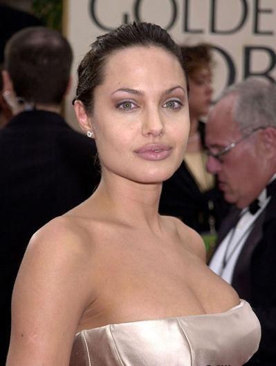 Jolie-Beckham Armani için poz verecek - 17