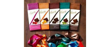 Lovells Portakal Krokanlı Bitter Çikolata  Ülker'in İngiliz çikolata markası Lovells'ten isim hakkını almasıyla Lovells çikolata çeşitleri market raflarında boy göstermeye başladı. Portakal krokanı ve portakal kullanılarak üretilen bu çeşidinde kakao kuru madde oranı en az yüzde 58. Portakalın kakaoyla uyumu nefis. Portakal kokusu da çikolatanın lezzetini artırıyor.  100 gr.'da;   591 kcal. enerji,  38.3 gr. yağ,  9.6 gr. protein