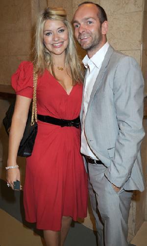 Holly eşi Dan Baldwin ile.   Çiftin 2009 Mayıs doğumlu, Harry adında bir oğulları var.