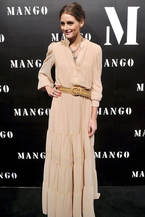 Olivia Palermo Her zaman çok şık görünen Olivia Palermo, uzun şeftali reng elbisesi ve taba kemeriyle vintage modasını çok iyi taşıyor.