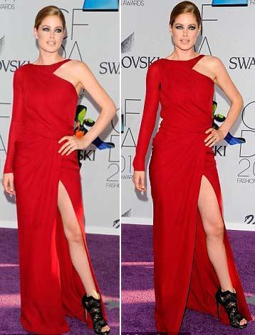 Seksi model Doutzen Kroes, asimetrik kesimli ve derin yırtmaçlı kırmızı elbisesiyle poz verdi.