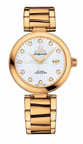Ladymatic gold watch © Omega