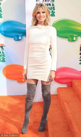 Fotoğraftaki genç kız, Alman top model Heidi Klum'dan başkası değil. Ünlü modeli yılların nasıl değiştirdiğini fotoğraflar gözler önüne seriyor.