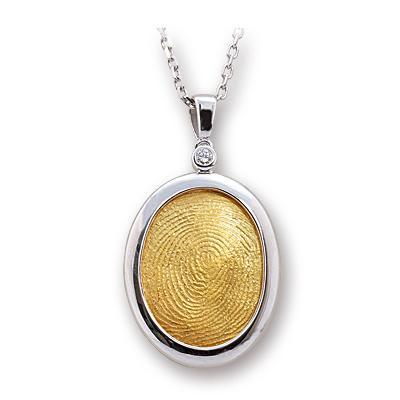 18 Ayar Yeşil Beyaz Altın Pırlantalı Parmak İzi Kolye  Ariş'in en çok talep gören parmak izi tasarımlarından biri. Sadeliği ve inceliği ile gerçek bir mücevher. Dahası, özel anlamlarıyla kalıcı bir yadigar...