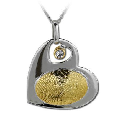 Pırlanta Parmak İzi Kalp Kolye Altın Ligia  Doğal kimliğiniz; parmak iziniz ilk kez mücevhere hayat veriyor.