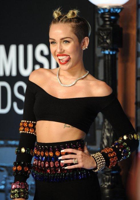 Miley Cyrus'un en çarpıcı fotoğrafları - 13