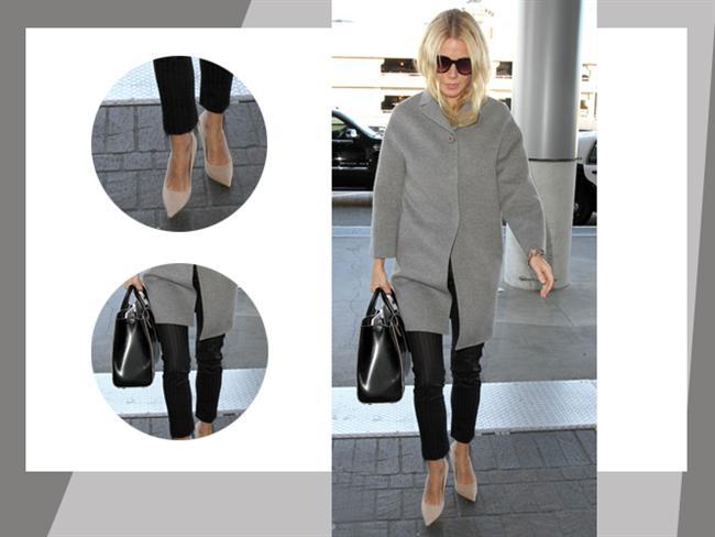 """Bu hafta """"Kim Ne Giydi?"""" bölümünde modern-klasik stiliyle Gwyneth Paltrow'u ele aldık. Ünlü oyuncu krem rengi stilettoları ve grazer pantolonu ile sade ama şık bir hava yakalamış. Bu kıyafeti ister ofiste, ister iş sonrası partide ya da bir yemekte rahatlıkla kullanabilirsiniz. Galerimiz içerisinden Gwyneth 'in üzerindeki kıyafet ve aksesuarları satın alarak siz de aynı stili yakalayabilirsiniz. Hadi sizin için seçtiğimiz parçalara bir göz atın..."""