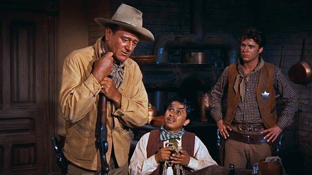 Kahramanlar Şehri (1959)  Gelmiş geçmiş en iyi Western filmleri arasında gösterilen filmde, Şerif John T. Chance ve iki yardımcısı kasabada işlenen cinayetlerin peşine düşerler. Ancak yardımcılarının birinin çok genç, birinin de alkolik olması onun başına türlü belalar açar.