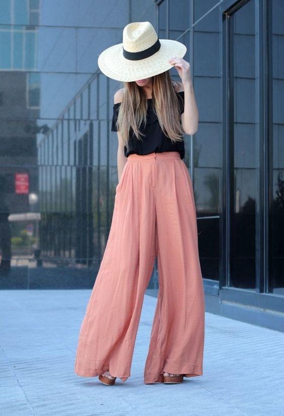 Bol Paçalı Pantolonlar:  Geniş paçalı pantolonlar da sizi daha uzun gösterecektir.