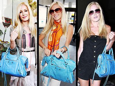 """Heidi Montag, kendisine ait hesaplı bir marka olan """"Heidiwood"""" bir yana dursun, kendisi hala lüksten hoşlanıyor; 1.495 Dolarlık parlak mavi Balenciaga çantasını yanından ayırmıyor!"""